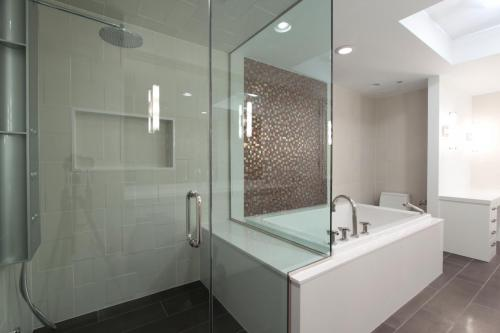 contemporary-bathroom-with-frameless-shower-and-copper-color-accent